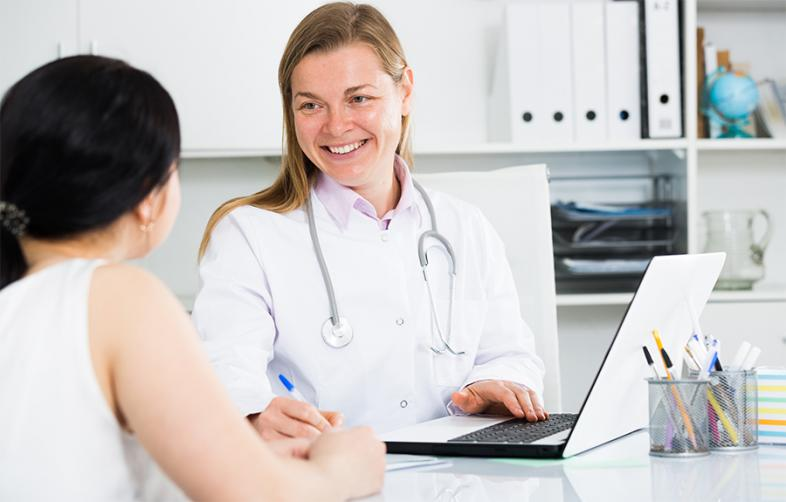 Woman visiting female doctor